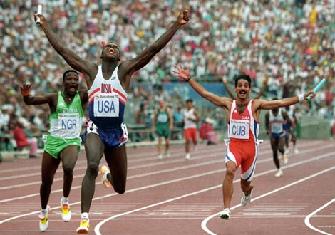 Carl Lewis, Davidson Ezinwa & Jorge Aguilera, celebrate podium places for USA, Nigeria & Cuba respectively, as they cross the finish line of the men's 4x100m at Barcelona '92
