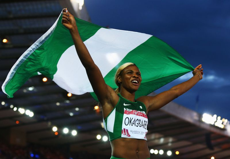 Blessing Okagbare celebrates winning 100m GOLD at the 2014 Commonwealth Games in Glasgow  (Photo credit: Cameron Spencer/Getty Images)