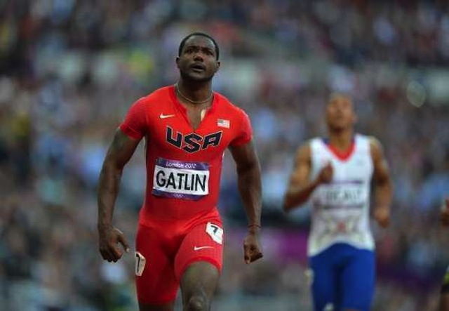 Gatlin ruled the men's 100m event in 2014 and topped the 100m and 200m standings at the end of the season. (Photo Credit: Eric Feferberg / AFP / Getty Images)