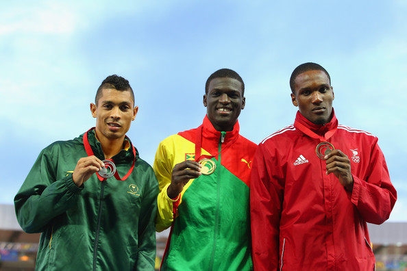 James (C) poses with Silver medallist Wayde van Niekerk of South Africa (L) and Bronze medallist Lalonde Gordon (R) of Trinidad and Tobago in Glasgow. (Photo Credit: Mark Kolbe/Getty Images Europe)