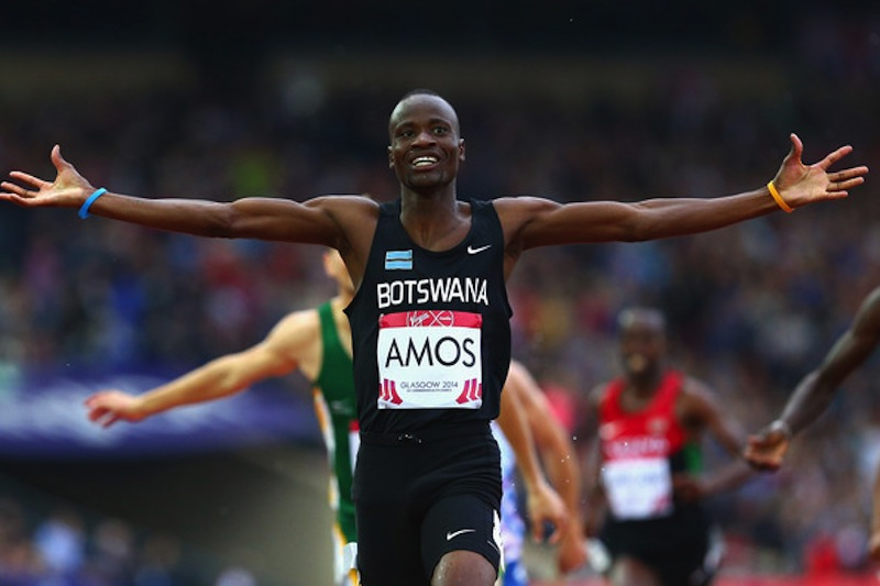 Nijel Amos triumphantly crosses the line as 800m Champion at the 2014 C'wealth Games! (Photo Credit:  Cameron Spencer/Getty Images Europe)