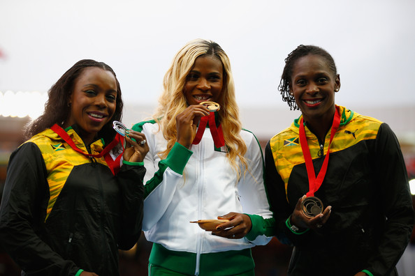 Okagbare flanked by the Jamaican duo of Silver medallist Veronica Campbell-Brown of Jamaica (L) and Bronze medallist, Kerron Stewart in Glasgow. (Photo Credit: Clive Rose/Getty Images Europe)