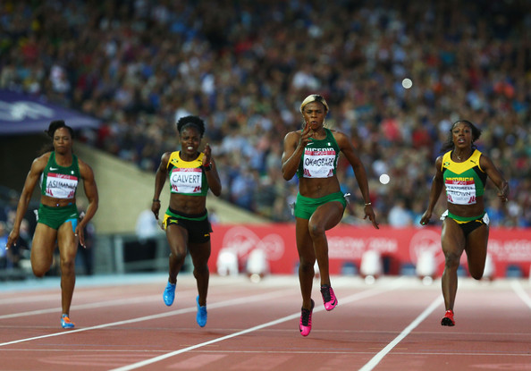 Okagbare (2R) crosses the line to win gold ahead of Jamaica's Veronica Campbell-Brown (R) in the Women's 100m  atthe Glasgow 2014 Commonwealth Games in Glasgow. (Photo Credit: Cameron Spencer/Getty Images)