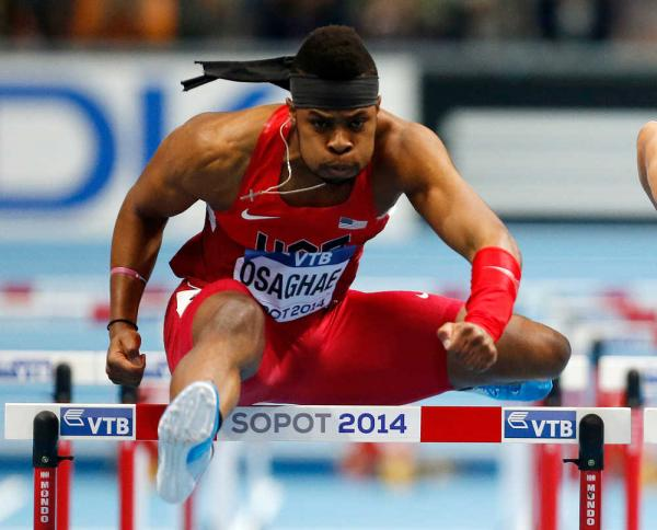Omo Osaghae clears a hurdle in his 60m hurdles semifinal during the 2014 IAAF Indoors in Sopot, Poland. (Photo Credit: AP /Petr David Josek)