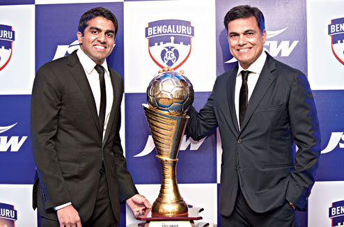 Parth Jindal (left) and his father, Sajjan Jindal with the I-League trophy won by their team, Bengaluru FC in their very first season. (Photo Credit: http://www.telegraphindia.com)