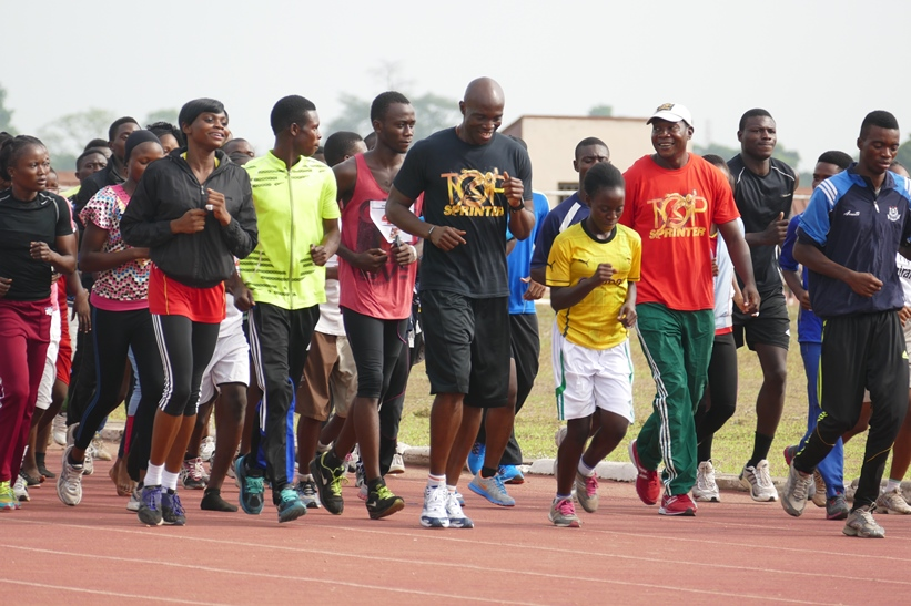 Top Sprinter Coaches Francis Obikwelu and Deji Aliu take the athletes through their paces in warmup in Ibadan