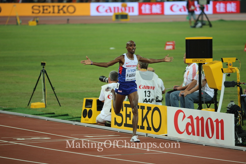 Mo Farah spreads out both hands as he crosses the finish line to win the 5000m in style. Photo Credit: Making of Champions/PaV media