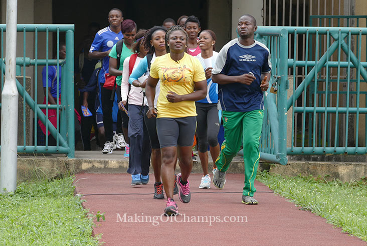 Coach Glory Alozie leading her team out for a training session.