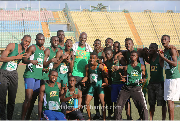 Coach Francis Obikwelu strikes a pose with his team.