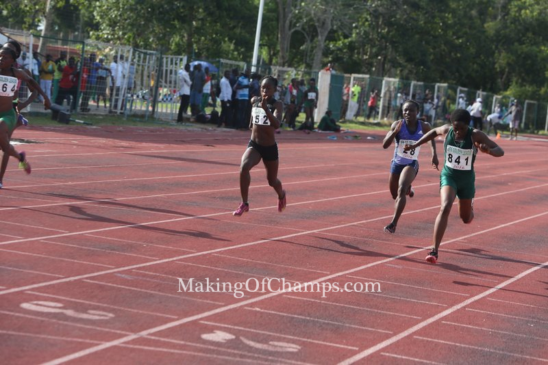 MoC's Joy dipping in first to win the women's 100m B final.
