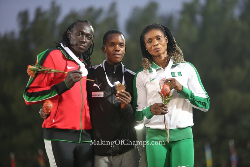 (L-R) Nyairera, Mupopo and Okon-George pose with their medals.