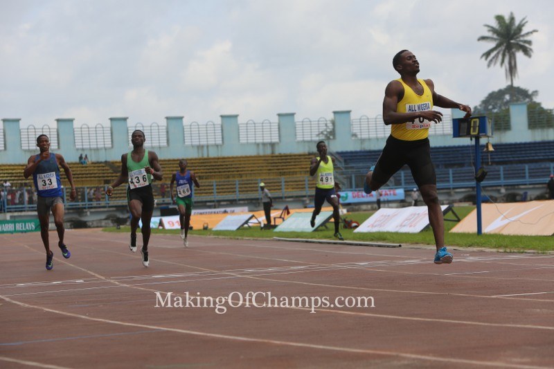 Dedewo races to the finish line in the last heat of the men's 400m