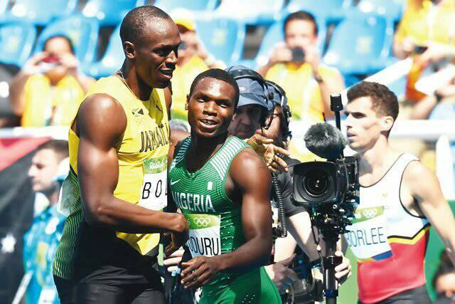 Divine Oduduru shaking Usain Bolt after their 200m race at the Rio 2016 Olympics. Photo Credit: Jewel Samad, Getty Images