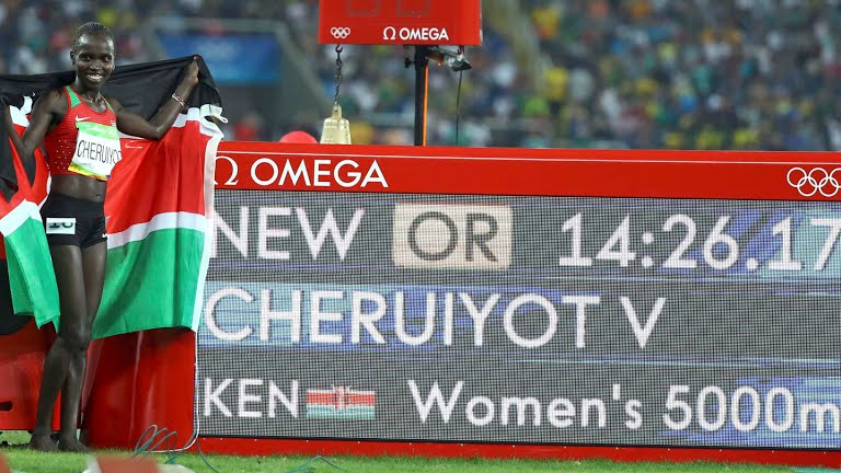 Vivian Cheruiyot standing by her new Olympic record in women's 5000m. Photo credit: Rio2016