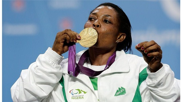 Esther Onyema celebrates winning a medal for Nigeria. Photo Credit: Getty Images via m.paralympic.org