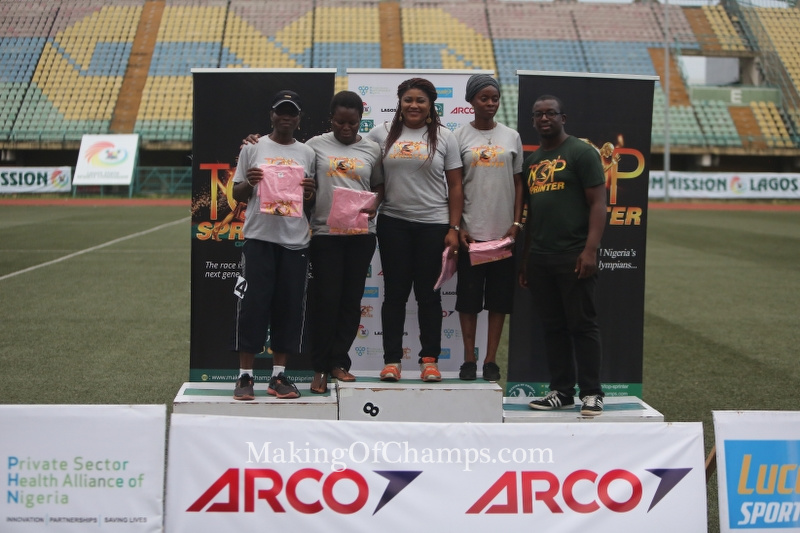 Competitors in the women's Masters race receive their prizes from MoC Founder, Bambo Akani.