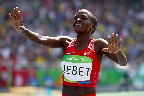 Jebet celebrates winning Bahrain's first ever Olympic GOLD medal in any sport. Photo Credit: Getty Images