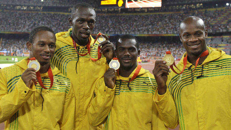 L-R: Michael Frater, Usain Bolt, Nesta Carter and Asafa Powell pose with their GOLD medal at the Beijing Olympics. Photo Credit: AP