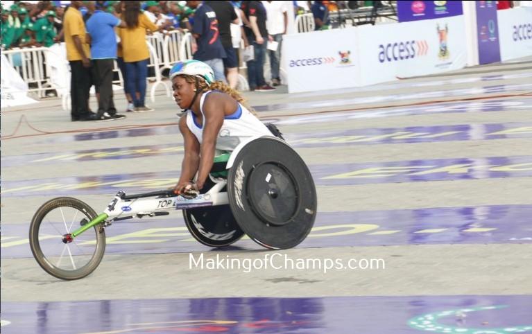 Hannah Babalola wins the women's 10km Wheelchair Race at the Access Bank Marathon.